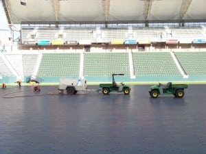 full tractors on base panels for football field turf installation